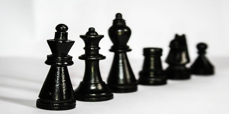 black chess pieces demonstrating business hierarchy