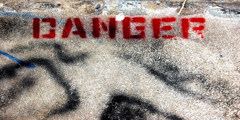 danger notice painted on ground