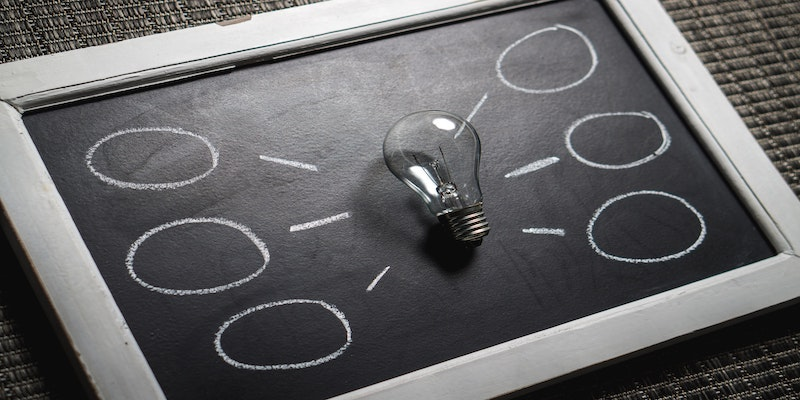 lightbulb on chalkboard signifying understanding