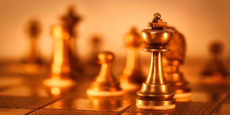 blurry chess board with king in focus to signify leadership