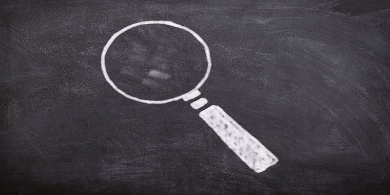drawing of magnifying glass on chalkboard