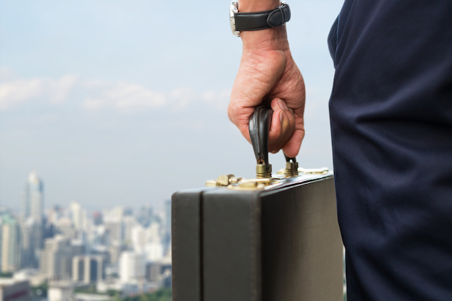 businessman with briefcase leaving city feature